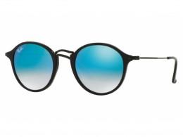 5b0a292b659bb Óculos de Sol Ray-Ban Redondo Armação Acetato Preta Lente Azul Espelhada  Sem Plaquetas 0rb2447901